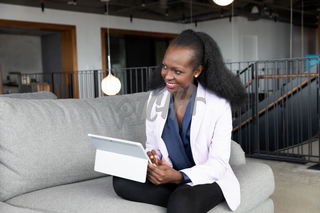 Black woman at work holding a tablet