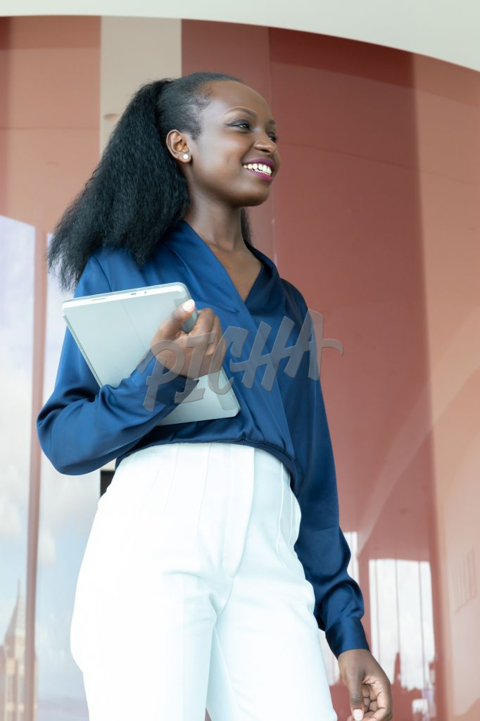 woman holding a tablet at work