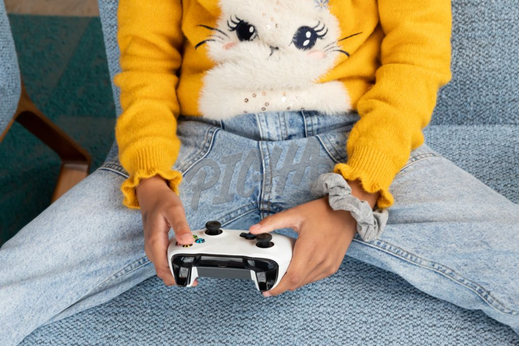 young girl playing video games