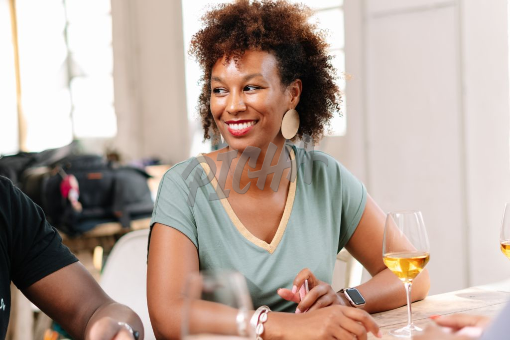 Woman enjoys a drink with company