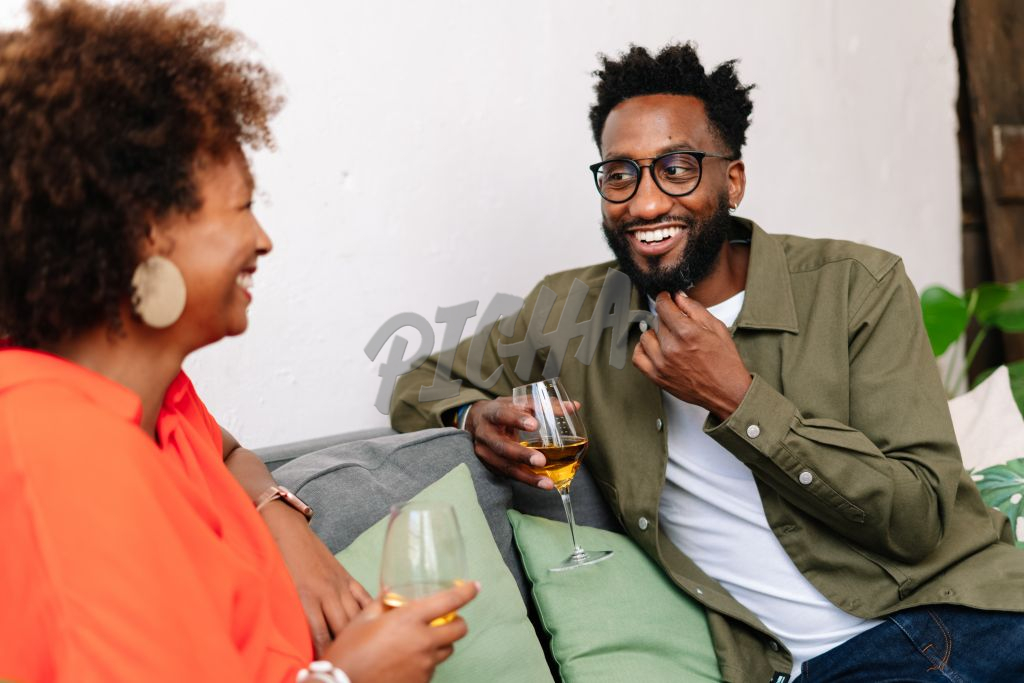 Man and woman socialise over a glass of wine