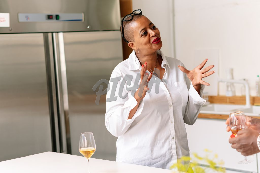 Woman has a chat while enjoying some wine