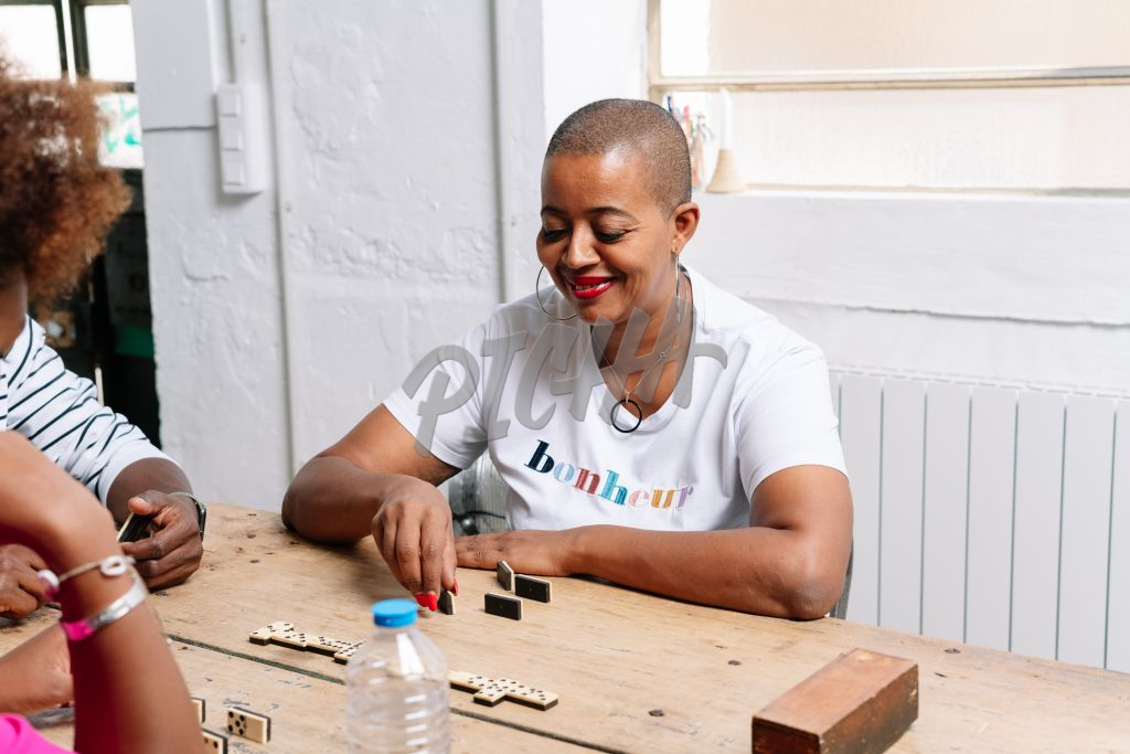 Lady playing dominoes
