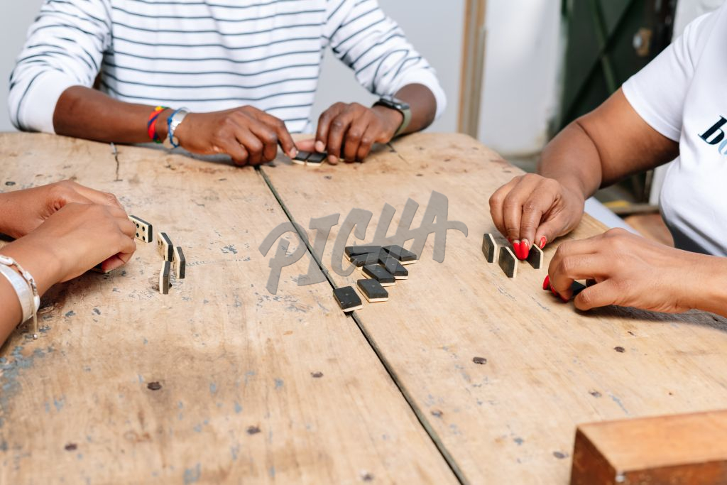 Friends playing dominoes