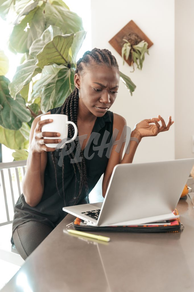 woman wears concerned expression while working