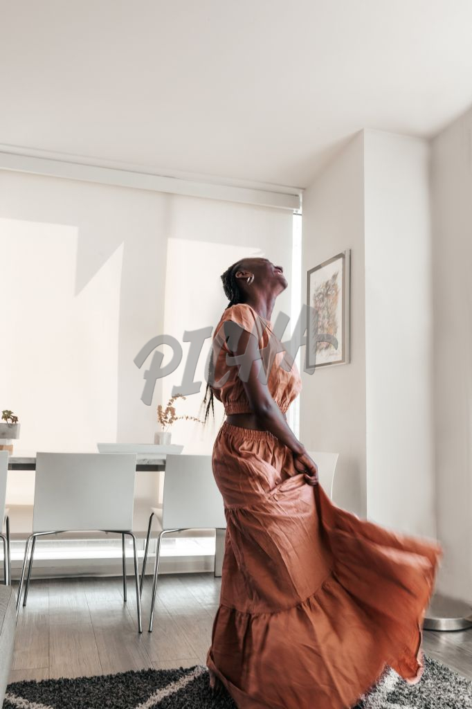 woman in flowing dress moving with joy
