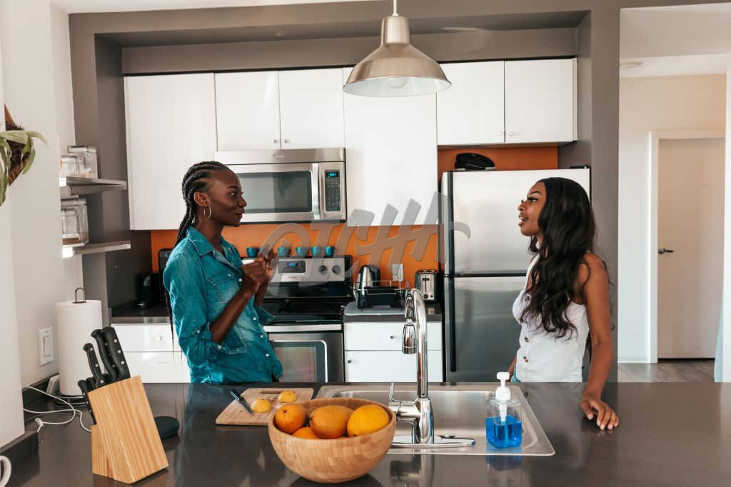 friends chatting in the kitchen