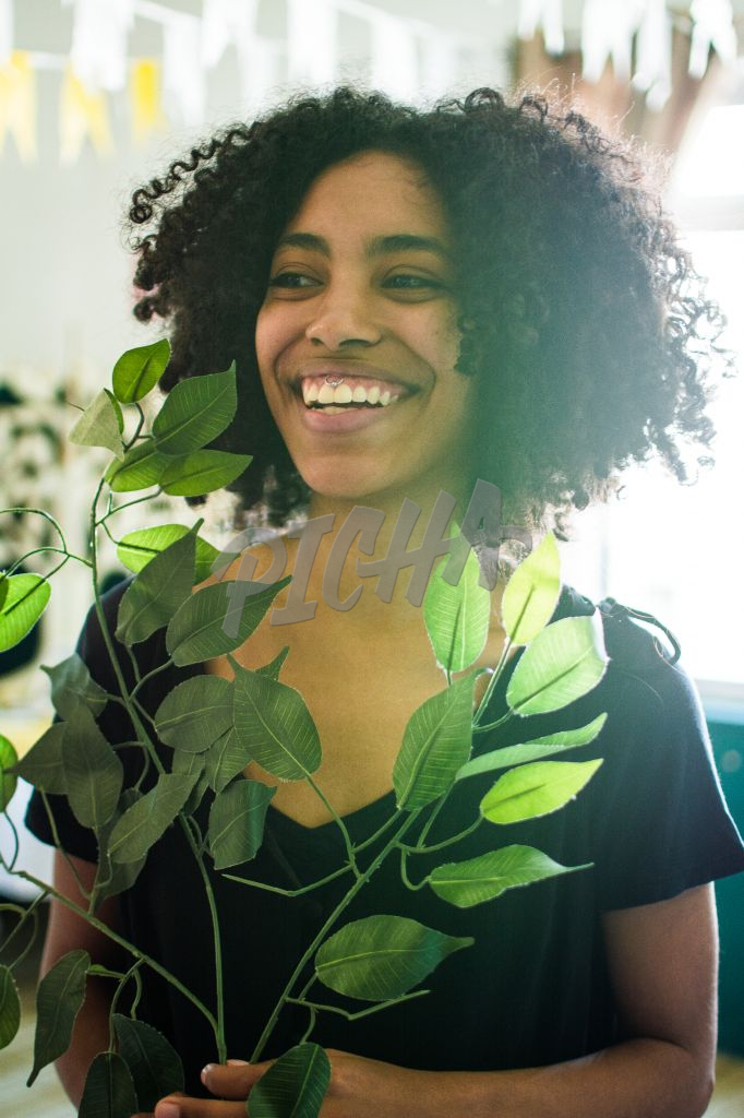 Portrait of beautiful woman holding a plant