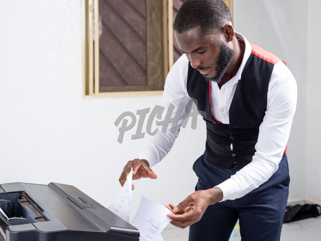 Young Professional using a printer