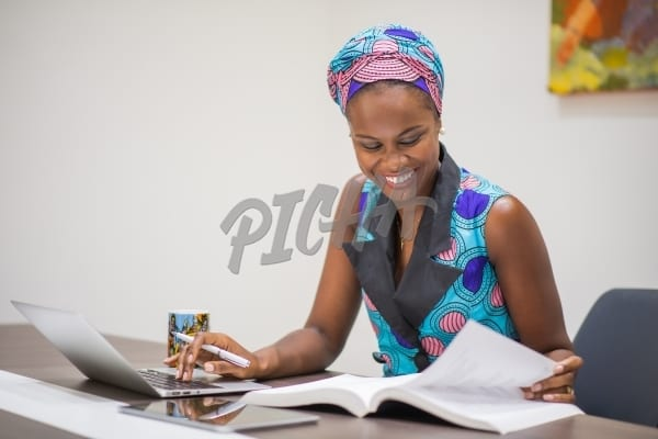 Smiling woman working at her desk