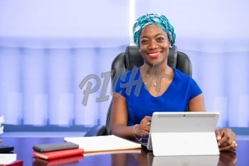 Professional woman sitting at her desk